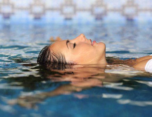 Woman floating in pool