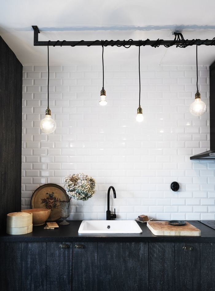 Industrial lights, subway tiles, natural elements, this kitchen has it all! via BWA's Pinterest