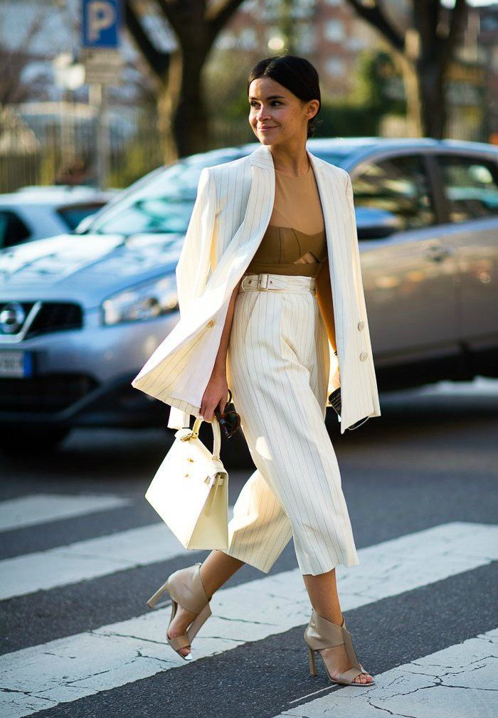 Miroslava Dumacarrying off a croppedpinstripe suit. Found on whowhatwear.com