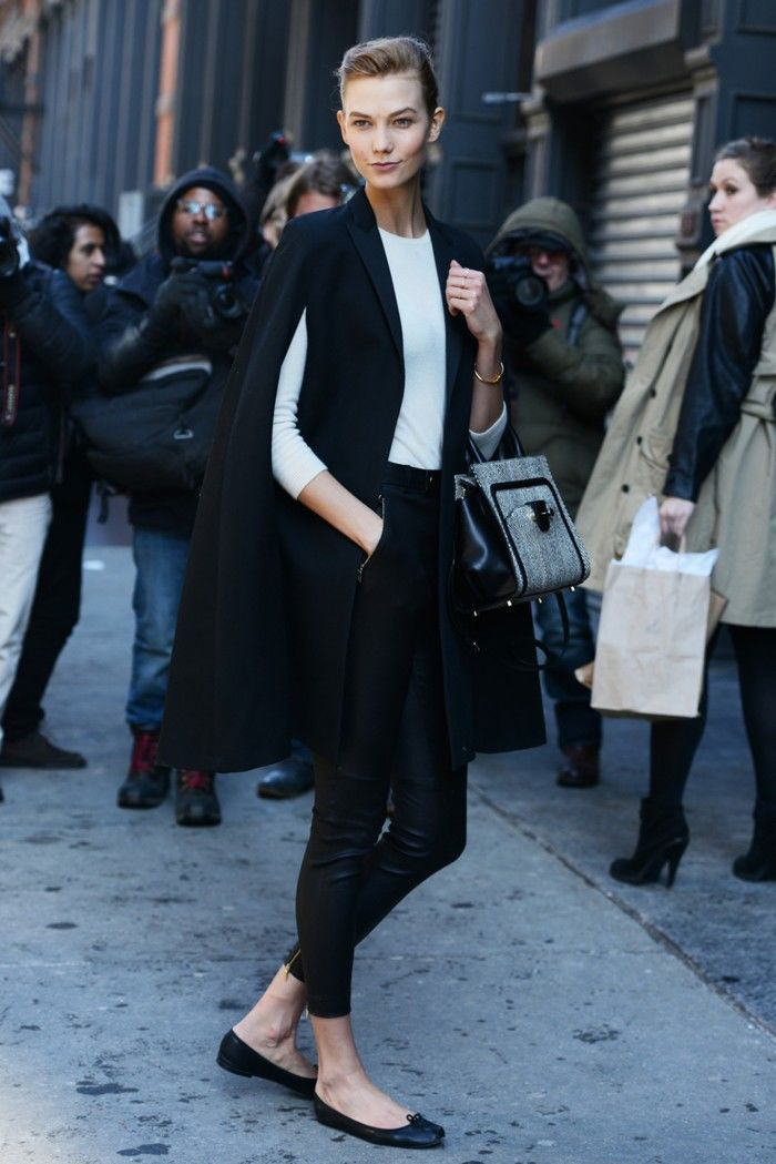 Karlie Kloss in a minimalistic, caped look. Image: style.com