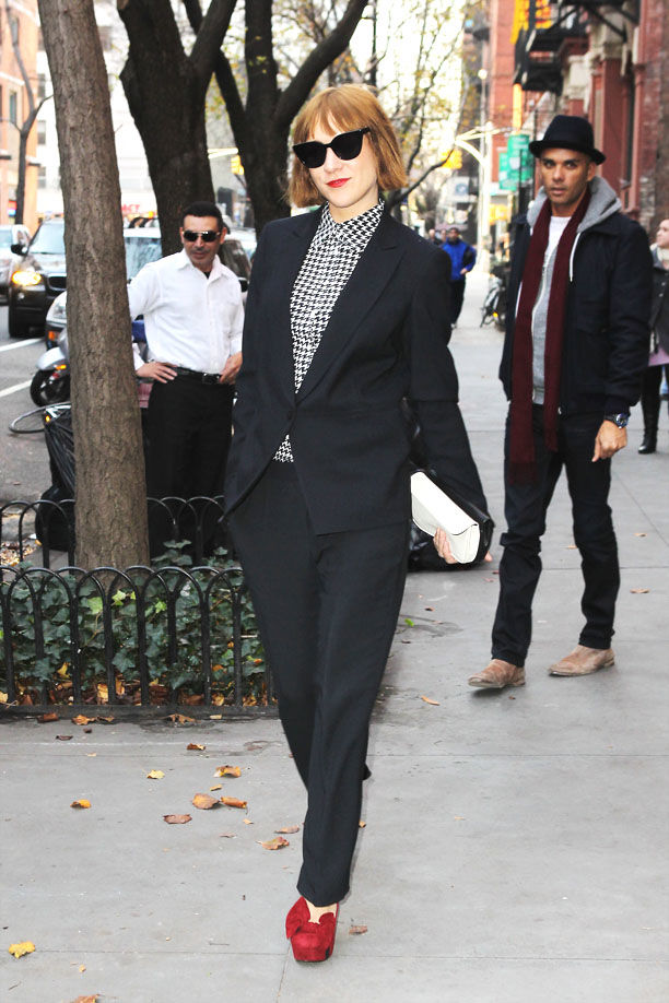 Chloe Sevigny, looking chic in a black pantsuit, poses for photographers on the street in New York City